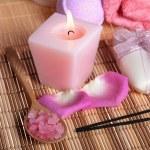 Spa treatment: sea salt, candle, soap, roses petals — Stock Photo