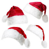 Santa Claus caps isolated on a white background — Stock Photo