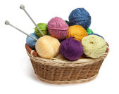 Knitting yarn balls and needles in basket — Stok fotoğraf