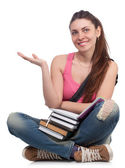 Beautiful student girl sitting with books — Stock Photo