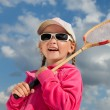Little girl with racket for badminton — Stock Photo