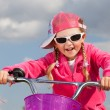 Little girl on bicycle — Foto de stock #12597959