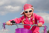 Little girl on bicycle — Photo