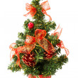 Small christmas tree with bows and cones — Stock Photo