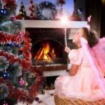 Little fairy girl with magic wand near a Christmas tree — Stock Photo #13436990