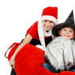 Stock Photo: Two happy boys with Witch and Santa Claus Hat