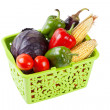 Vegetables in green shopping basket - Stock Photo