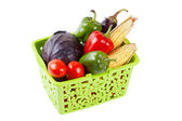Vegetables in green shopping basket — Stock Photo