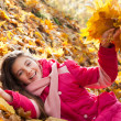 Stock Photo: Girl with autumn leaves