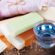 Body care accessories: towels, sea salt, soap, pumice stone and - Stock Photo