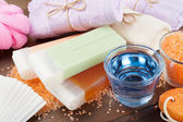 Body care accessories: towels, sea salt, soap, pumice stone and — Stockfoto
