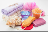 Body care accessories: towels, sea salt, soap, pumice stone, oil — Stock Photo