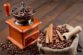 Coffee grinder and sack with coffee beans — Stock Photo