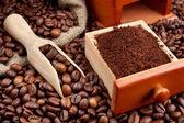 Coffee beans with wooden scoop — Foto de Stock