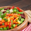 Mixed vegetables in wooden bowl — Stock Photo #17616991