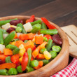 Mixed vegetables in wooden bowl - Stock Photo