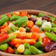 Mixed vegetables in wooden bowl — Stockfoto