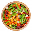 Foto Stock: Mixed vegetables in wooden bowl isolated, top view