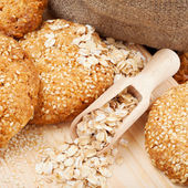 Cookies with sesame seeds on wooden board — Stock Photo