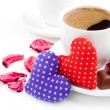 Two coffee cups, hearts, rose petals and chocolate candies for V - Stock Photo