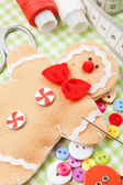 Sewing set and handmade gingerbread man from textile — Stock Photo