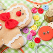 Stock Photo: Sewing set and handmade gingerbread man from textile