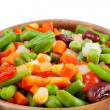 Mixed vegetables in wooden bowl — Stock Photo