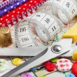 Sewing items: buttons, colorful fabrics, scissors, measuring tap — Foto de stock #19831539