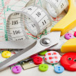 Stock Photo: Sewing items: buttons, scissors, measuring tape on sewing patte