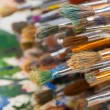 Art brushes on artist palette — Stock Photo