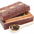 Tea box with wooden spoon — Stock Photo