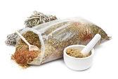 Bag of healing herbs, mortar and pestle, herbal medicine — Stock Photo