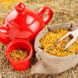 Bag with healing herbs and red tea kettle, herbal medicine  — Stock Photo