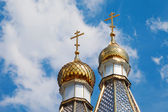 Golden dome of church on blue sky background — Stok fotoğraf