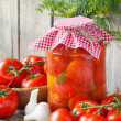 Homemade tomatoes preserves in glass jar. Fresh and canned tomat — Stock Photo