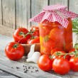 Homemade tomatoes preserves in glass jar. Fresh and canned tomat — Stock Photo #27343319
