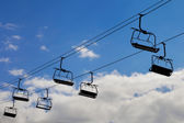 Chair lift, cableway on blue sky background — Stock Photo
