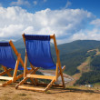 Two deckchairs in mountain — Stock Photo