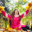 Girl with bouquets from autumn leaves — Stock Photo