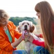 Stock Photo: Mother and her daughter with dog (Irish setter) outdoors
