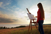 Artist painting an sea landscape — Stock Photo