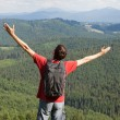 Happy man with hands up  on mountain — Stock Photo
