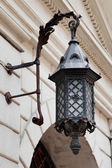 Decorative decorative street lamp on building wall — Stock Photo