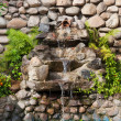 Decorative garden waterfall and pond made of stone — Stock Photo
