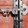 Closeup of a vintage wooden latch on a building — Stockfoto