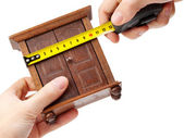 Woodworker measuring wardrobe with a tape measure, carpentry con — Stock Photo
