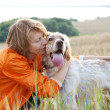 Woman with dog (Irish setter) outdoors — Stock Photo