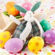 Cute Easter bunny rabbit with a little wheelbarrow and eggs — Stock Photo
