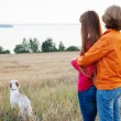 Mother and her daughter with dog (Irish setter) outdoors — Stock Photo