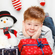 Happy smiling little boy with Christmas gift boxes — Lizenzfreies Foto